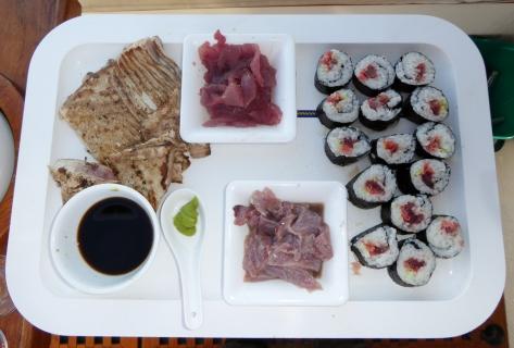 A plate of tuna dishes made with a blue fin tuna caught of the South Australian coast BBQ tuna, sashimi, sushi and ceviche.