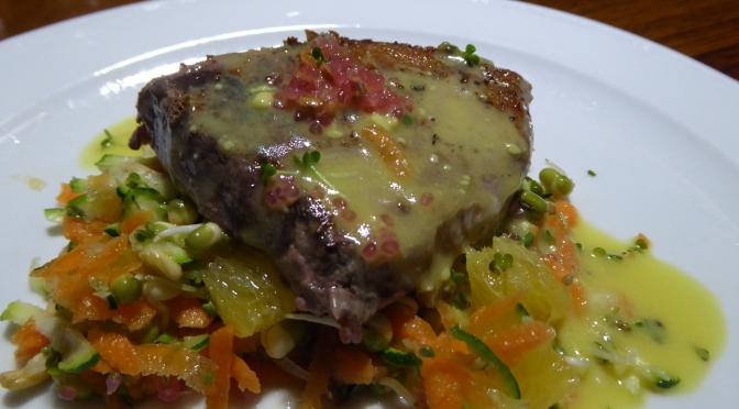 BBQ Tuna Steaks on a Sprout and Carrot Salad with an Orange Mustard Dressing.