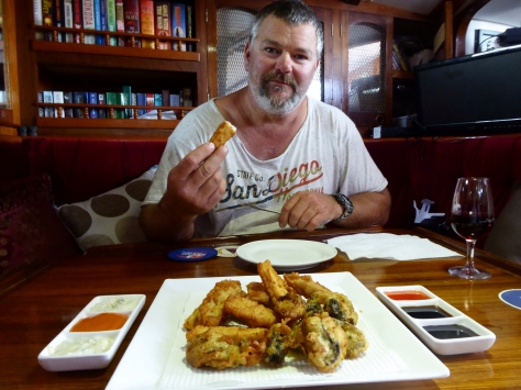 Dwayne eating a feast of beer battered marlin and huge oyster we got off the rocks!