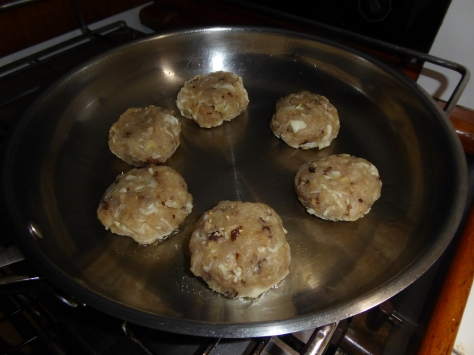 cooking marlin rissoles in a fry pan.