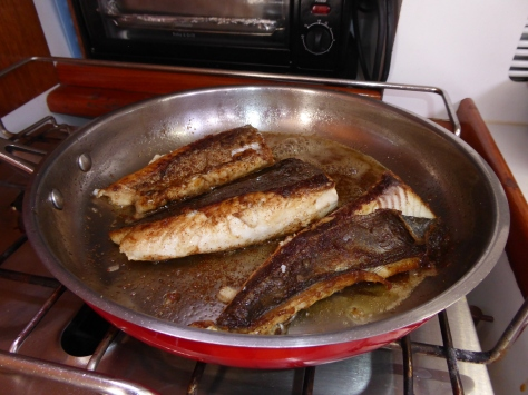 Frying up the Cajun Mackerel