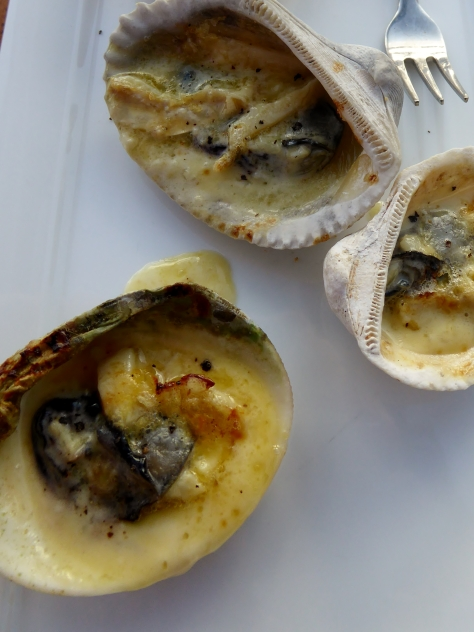 Oysters grilled with cream and camembert cheese.