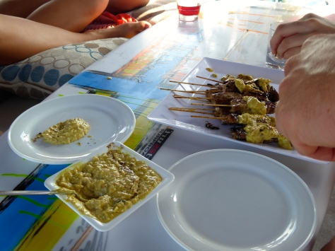 Sate Ikan served with peanut sauce on Jedd's surfboard!