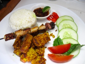 Nasi Campur - rice, tempe, octopus skewer, tomato, cucumber and sambal
