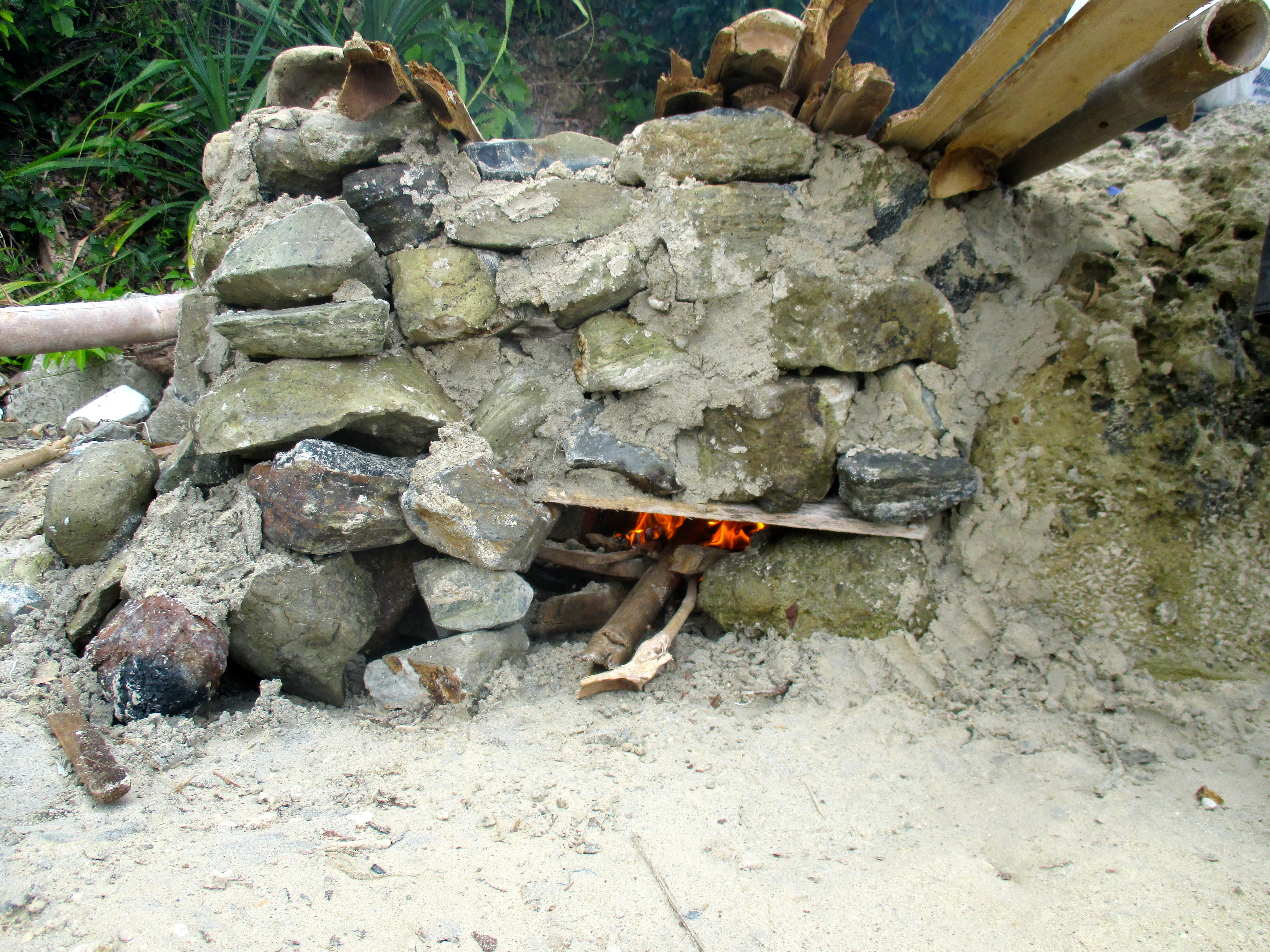 Feeding the beach oven bamboo