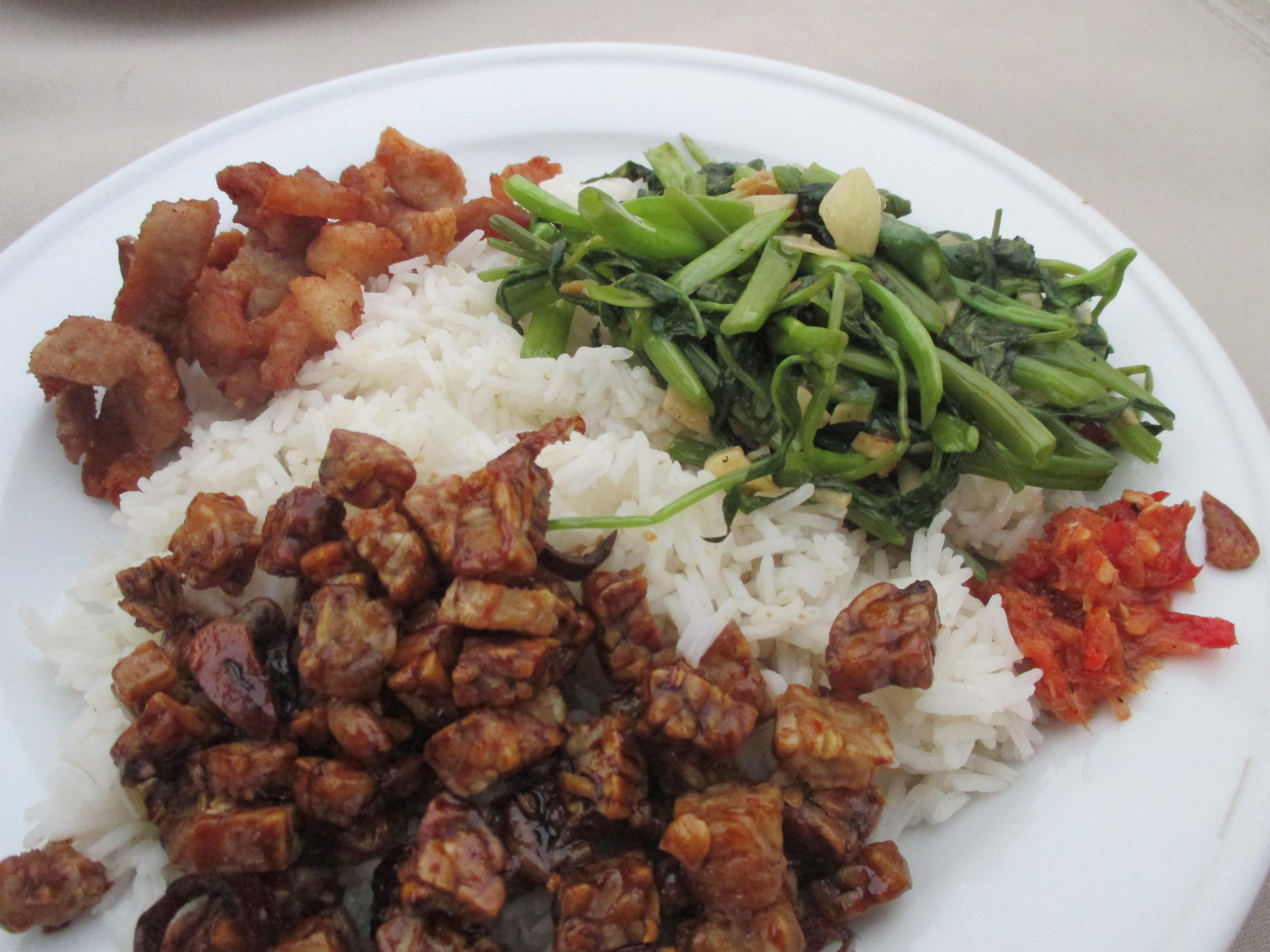 Nasi Campur - rice, crispy pork, tempe, kangkung (water spinach) and chilli sambal