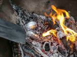 Cooking hot potatoes in the coals