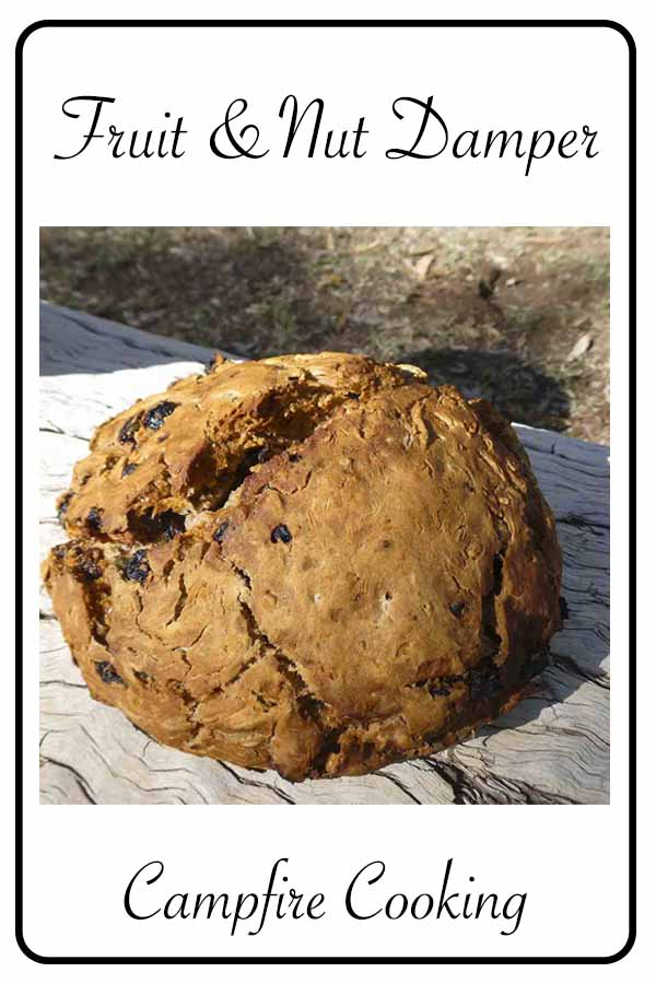 Fruit and Nut Damper cooked on the campfire over hot coals. Full of dried fruit, nuts, seeds and cinnamon. #campfirecooking #fruitandnuts #damper #campcooking